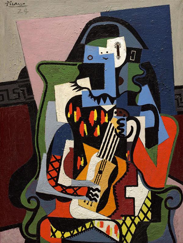 Картина Пабло Пикассо. Арлекин музыкант. 1924