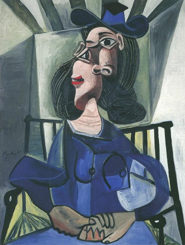 Картина Пабло Пикассо. Женщина в шляпе, сидящая в кресле. 1942